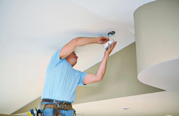 Speck Family Electric company installing a carbon monoxide alarm