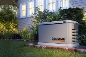 A whole home generator sitting outside home; this is great for power outage preparedness.
