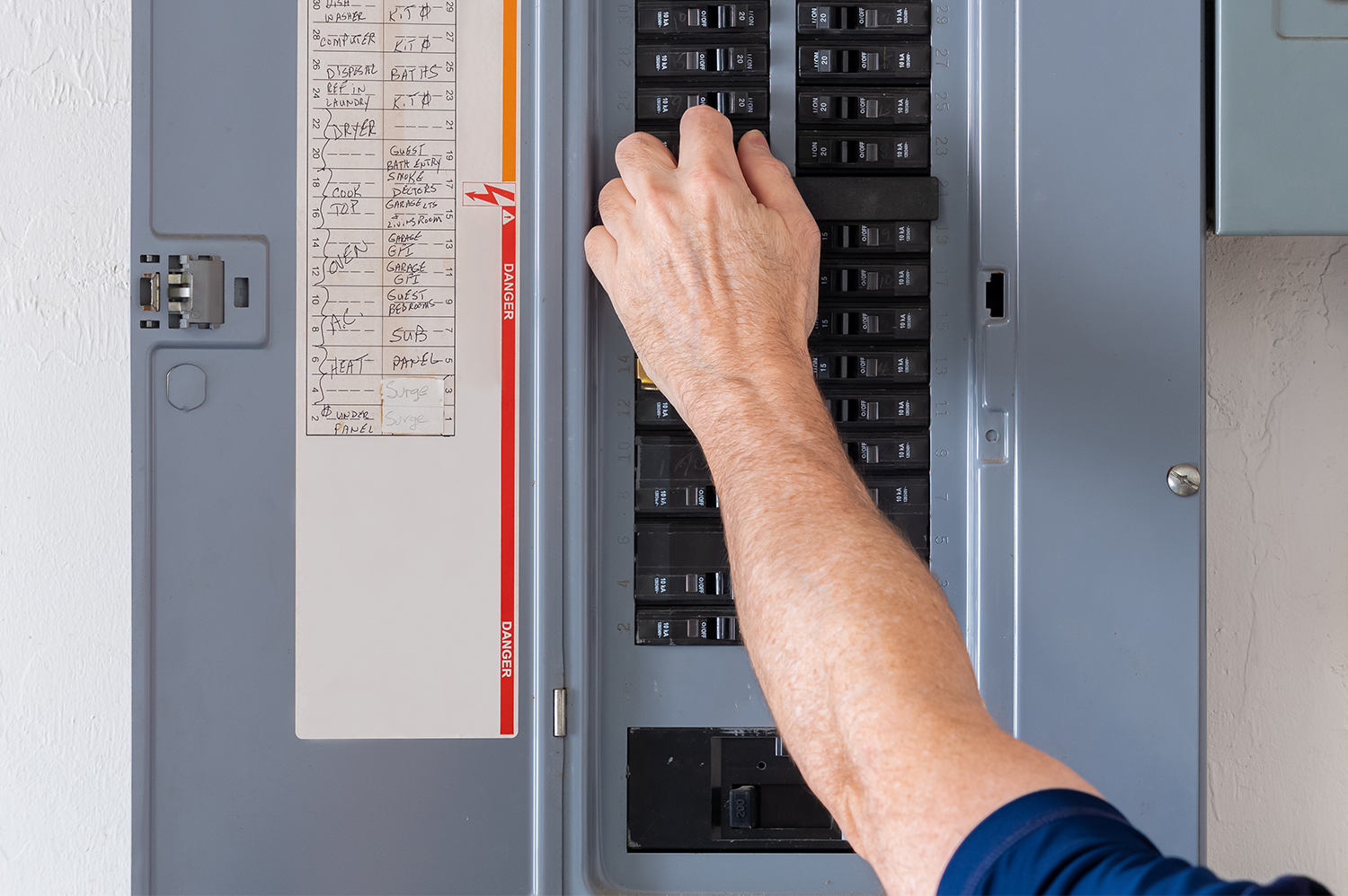 An electrician doing an electrical panel upgrade