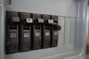 A close up shot of breaker switches with one switch flipped.